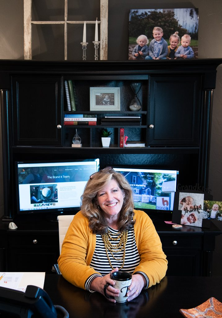 twyla-hayes-sitting-at-desk